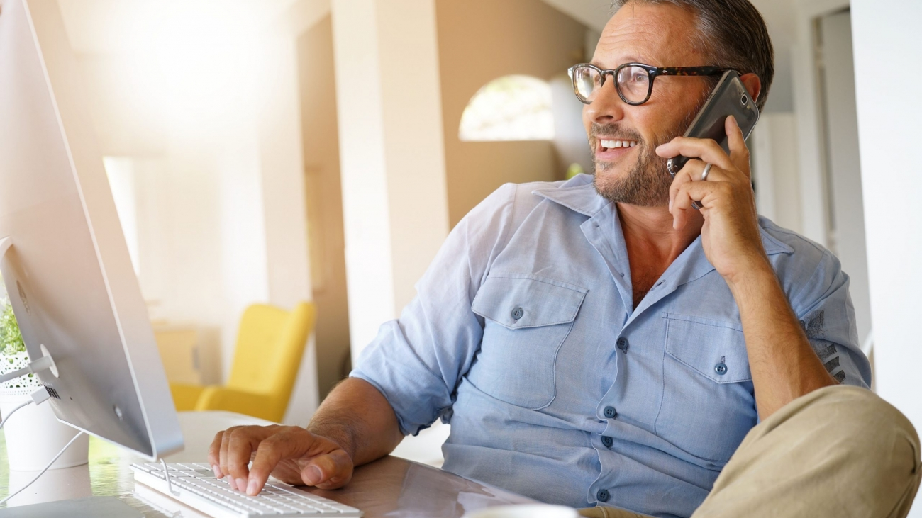 Home-office businessman talking on phone