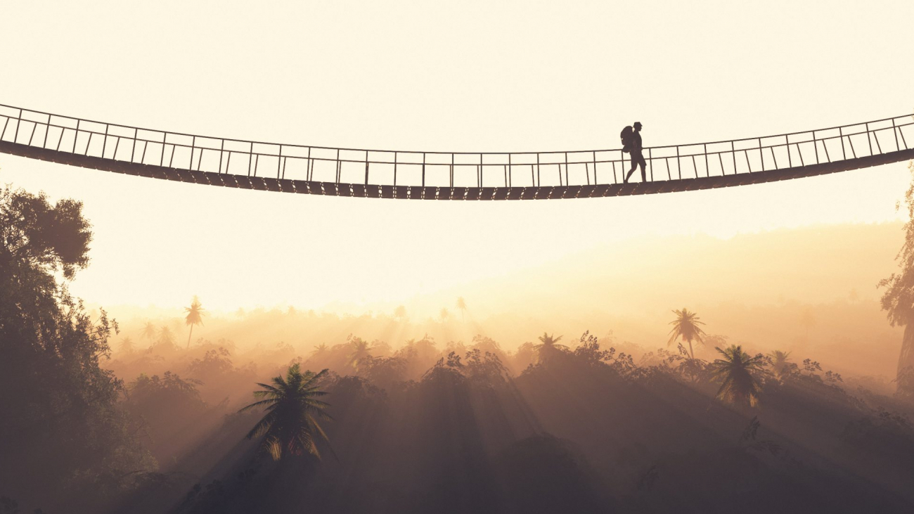"""Man rope passing over a bridge suspended between mountains. This is a 3d render illustration.""""n"""