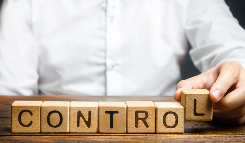 Man makes up the word Controls. Business and process management concept. Control Monitoring compliance with rules and responsibilities. Manage staff and workers. Self discipline