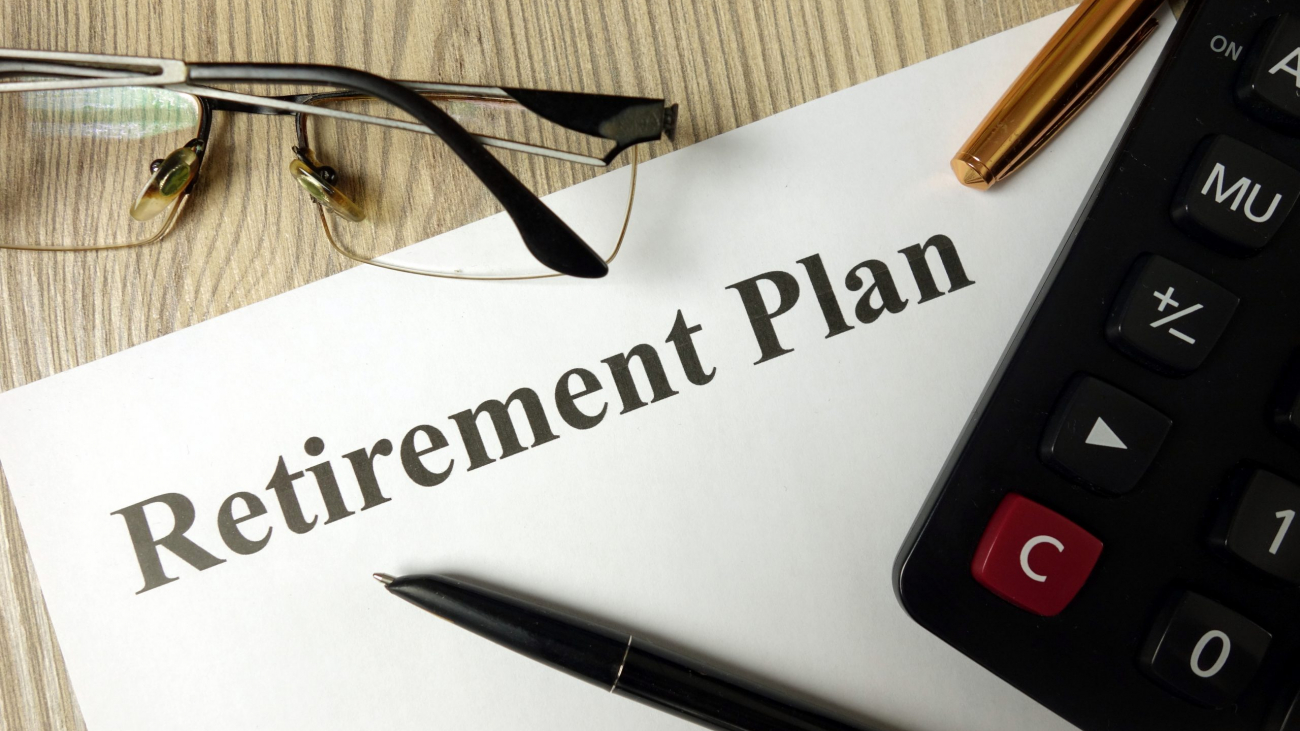 Retirement plan with calculator pen and glasses, personal finance planning