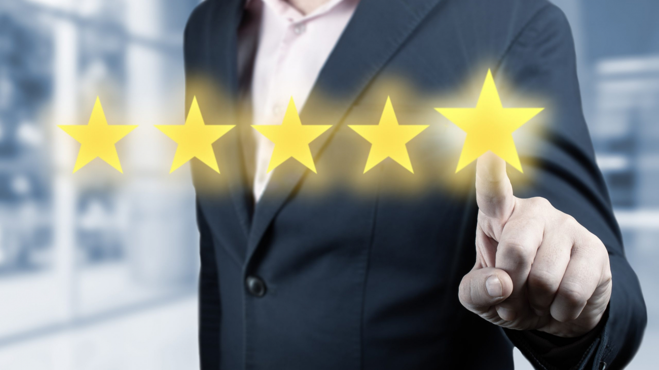 Businessman hand touching five star symbol. Man Is Pointing Five Stars - Review And Rating Concept. Person Pointing On 5 Star Review, Costumer Feedback Concept - Five Stars Rating