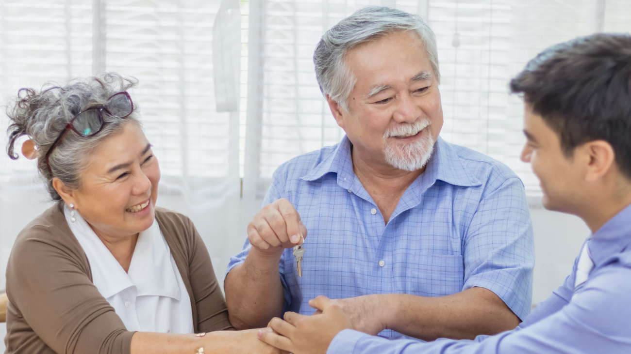 Happy retired Asian senior elderly couple hands shaking business deal and agreement with personal financial advisor or real estate agent. Retirement investment planning with professional counseling.